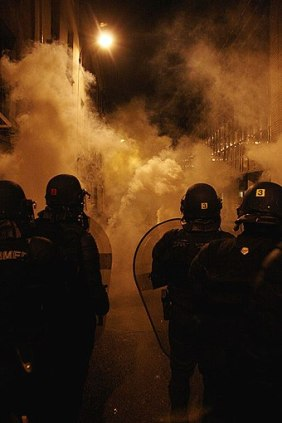 340px-Police_fighting_against_anti-Sarkozy_with_tear_gas_(487645695)